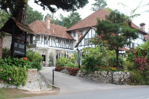 the Smokehouse hotel in the Cameron Highlands which looks like an old fashioned black and white Tudor building to be found in  the UK. Surrounded by trees and flowers and a short inclining driveway sweeping up to the entrance