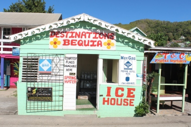Mint green shack set up as a shop on the island of Bequia in the Grenadines